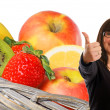 Woman shows a thumbs up from various fruits — Stock Photo #10128226