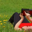 Stock Photo: Working with Tablet PC in nature