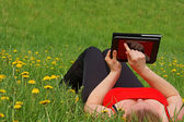 Working with a Tablet PC in nature — Stock Photo