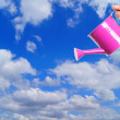 Watering can with clouds and blue sky — Stock Photo