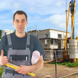 Construction worker in front of a building site — Stock Photo