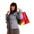 Attractive young girl with shopping bags — Stock Photo