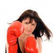 Athletic girl with boxing gloves — Stock Photo