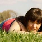 Pretty girl in the green grass — Stock Photo #9944986