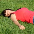 Dreaming pretty girl in the green grass — Stock Photo #9945345