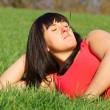 Dreaming pretty girl in the green grass — Stock Photo #9945694