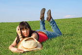 Pretty girl in the green grass — Stock Photo