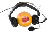 Happy orange with headphones — Stock Photo