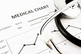 Medical chart with stethoscope — Stock Photo