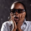 Stock Photo: South African woman watching 3D movie