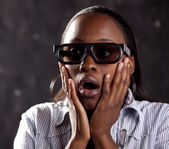 South African woman watching 3D movie — Stock Photo