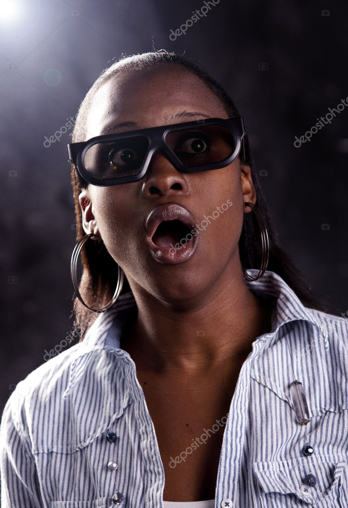 Gorgeous young woman watching a 3D movie, with 3D glasses on. — Stock Photo #10377330
