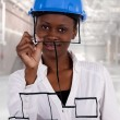 Woman holding pen to camera as white board — Stock Photo