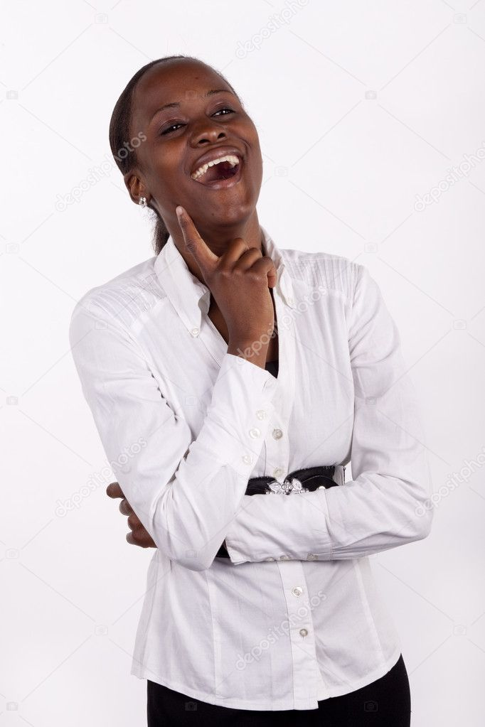 Beautiful young black woman laughing out loud.  Stock Photo #9108526