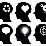 Black head profiles with idea symbols — Stock Vector #9170230