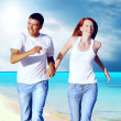Beautiful couple on the sunny tropical beach — Stock Photo #8781529