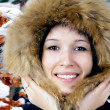 Portrait of happiness young woman in winter hat - Stock Photo