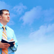 Hasppiness businessman under blue sky with clouds — Stock Photo