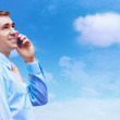 Hasppiness businessman under blue sky with clouds - Foto Stock