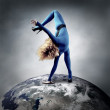 Ballerina stay in dancing pose on the Planet Earth. — Stock Photo