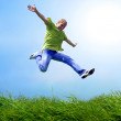 Royalty-Free Stock Photo: Fun man in jump on the outdoor background