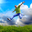 Fun man in jump on the outdoor background — Foto Stock