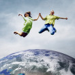 Fun couple in jump over the Planet Earth — Stock Photo #8782537