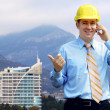 Young architect wearing a protective helmet standing on the moun — Stock Photo