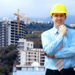 Young architect wearing a protective helmet standing on the moun — Stock Photo #8782726