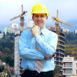 Young architect wearing a protective helmet standing on the moun — Stock Photo #8782729