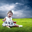 Happiness Baby girl sitting on the grass in field — Stock Photo