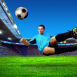 Football player on field of stadium - Stockfoto