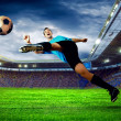 Football player on field of stadium — Stock Photo #8783904