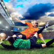 Football player on field of stadium - 