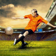 Football player on field of stadium — Stock fotografie