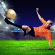 Football player on field of stadium - Stock Photo