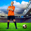 Football player on field of stadium — Foto Stock