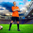 Football player on field of stadium — Stock Photo