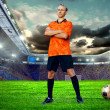 Football player on field of stadium - Stok fotoğraf