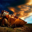 Yellow tractor on sky background — Foto de Stock