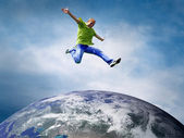 Fun couple in jump over the Planet Earth — Stock Photo