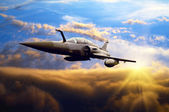 Military airplan on the speed — Stock Photo