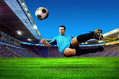 Football player on field of stadium — Stok fotoğraf