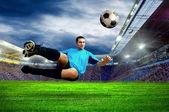 Football player on field of stadium — Stock Photo