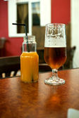 Beer and juice — Stock Photo