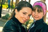 De vrouw met het kind — Stockfoto