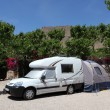 Camper van with tent on a camping site in Spain — Stock Photo