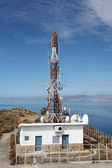 Communication tower with antennas at the coast — Stock Photo