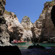 Stock Photo: Tourists discovering cliffs near Lagos, Algarve Portugal
