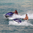 Young Arab men having fun riding jetski in Dubai — Stock Photo